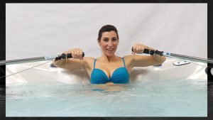 Woman rowing in swim spa