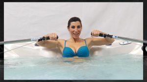 Woman rowing in swim spa
